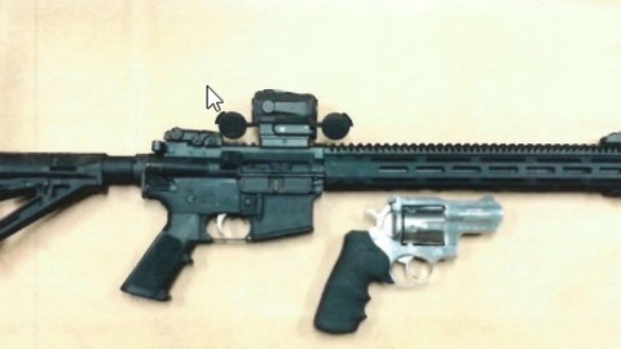 Man arrested, found in possession of stolen AR-15, .44