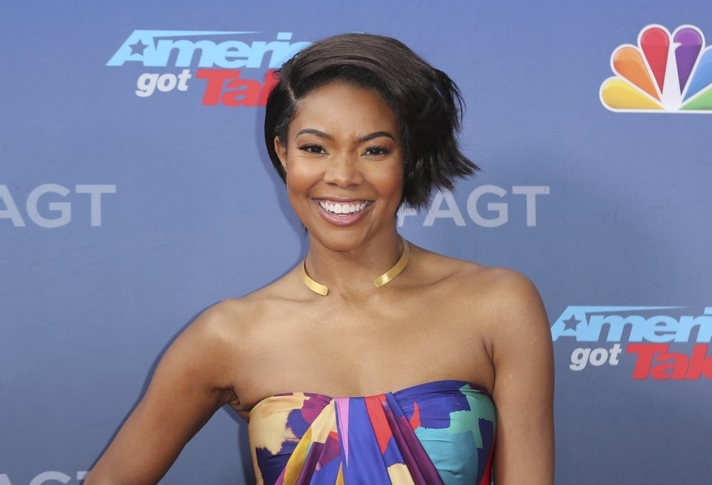 """This March 11, 2019 file photo shows Gabrielle Union at the """"America's Got Talent"""" Season 14 Kickoff in Pasadena, Calif. Union, who won a contract dispute with media giant Viacom over her BET series """"Being Mary Jane,"""" tells The Associated Press that based on what she's learned about actresses' salaries, there's """"no logical reasons"""" why actresses of color are paid less other than the color of their skin. (Photo by Willy Sanjuan/Invision/AP, File)"""