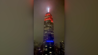 Empire State Building lights up with red and white siren to honor emergency workers
