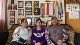 Alex Cuevas and parents