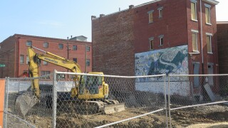 This photo shows construction equipment at the site of a new affordable apartment building being built as part of the LPH Thrives development in Lower Price Hill.