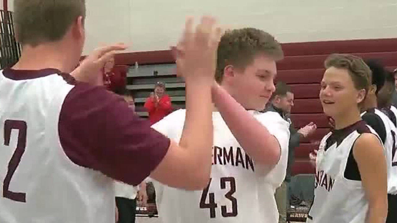 Eighth grader with autism steps onto the court