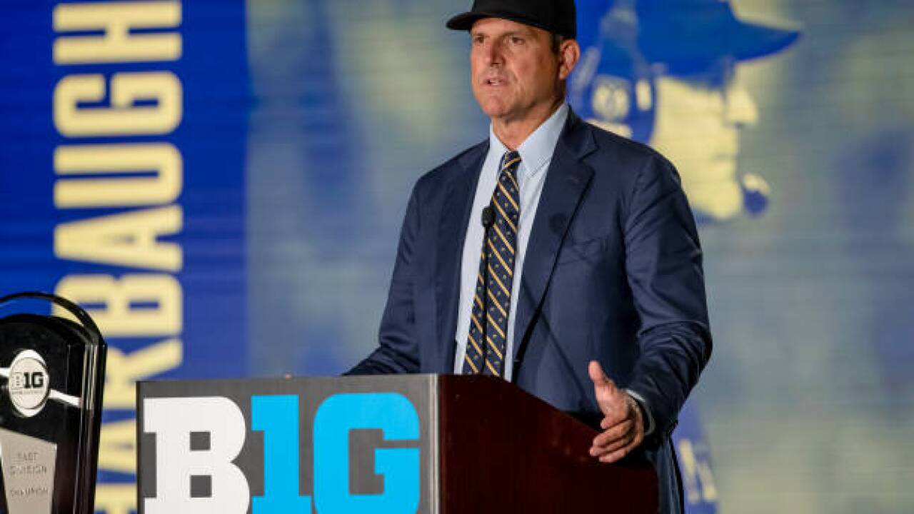 Michigan's Harbaugh says he wouldn't lie about transfer