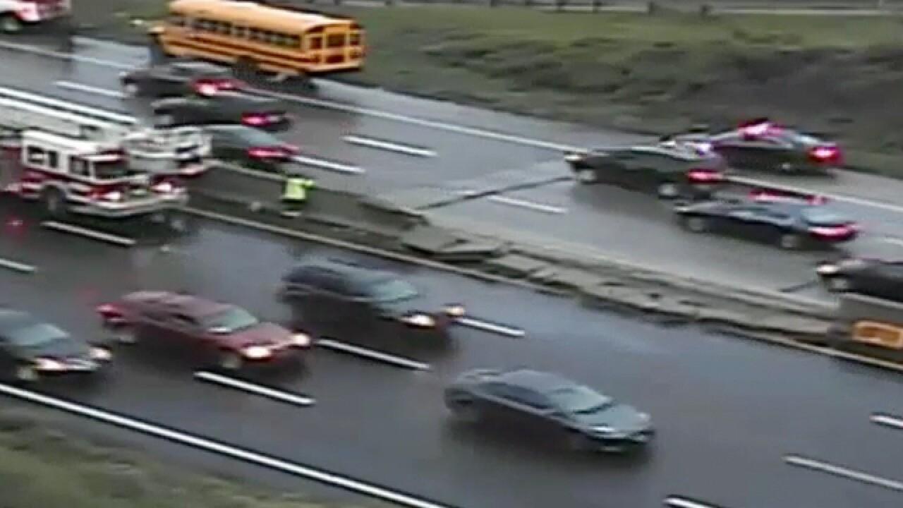 School bus destroys highway barrier