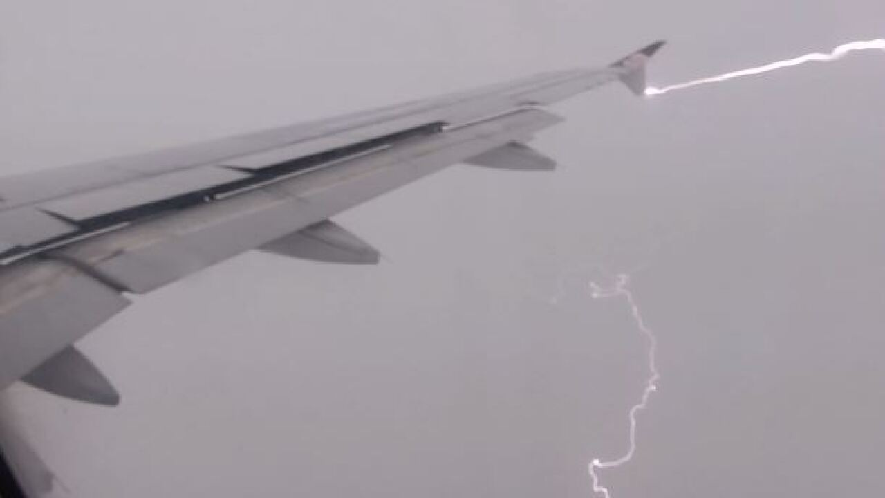 Lightning captured on camera striking airplane during descent into Salt Lake City