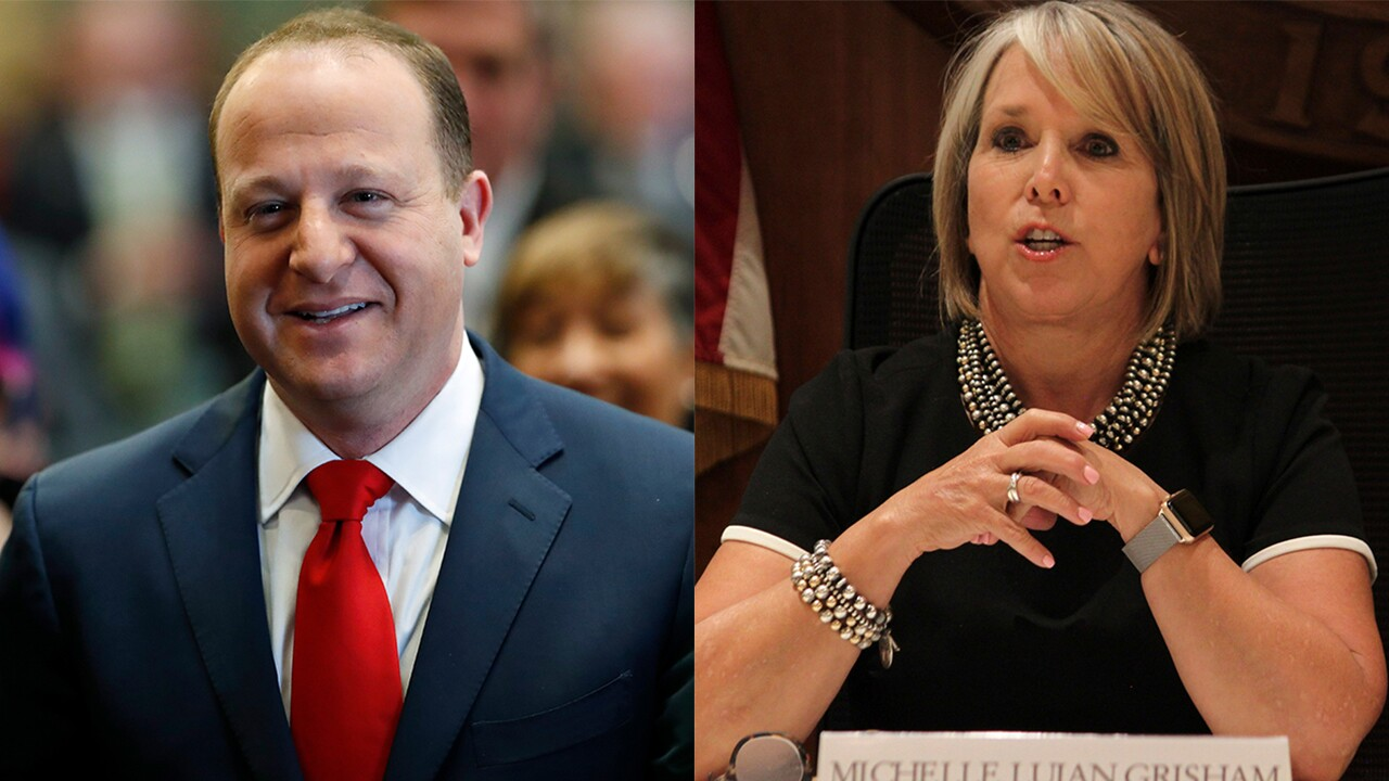 Polis and Lujan Grisham
