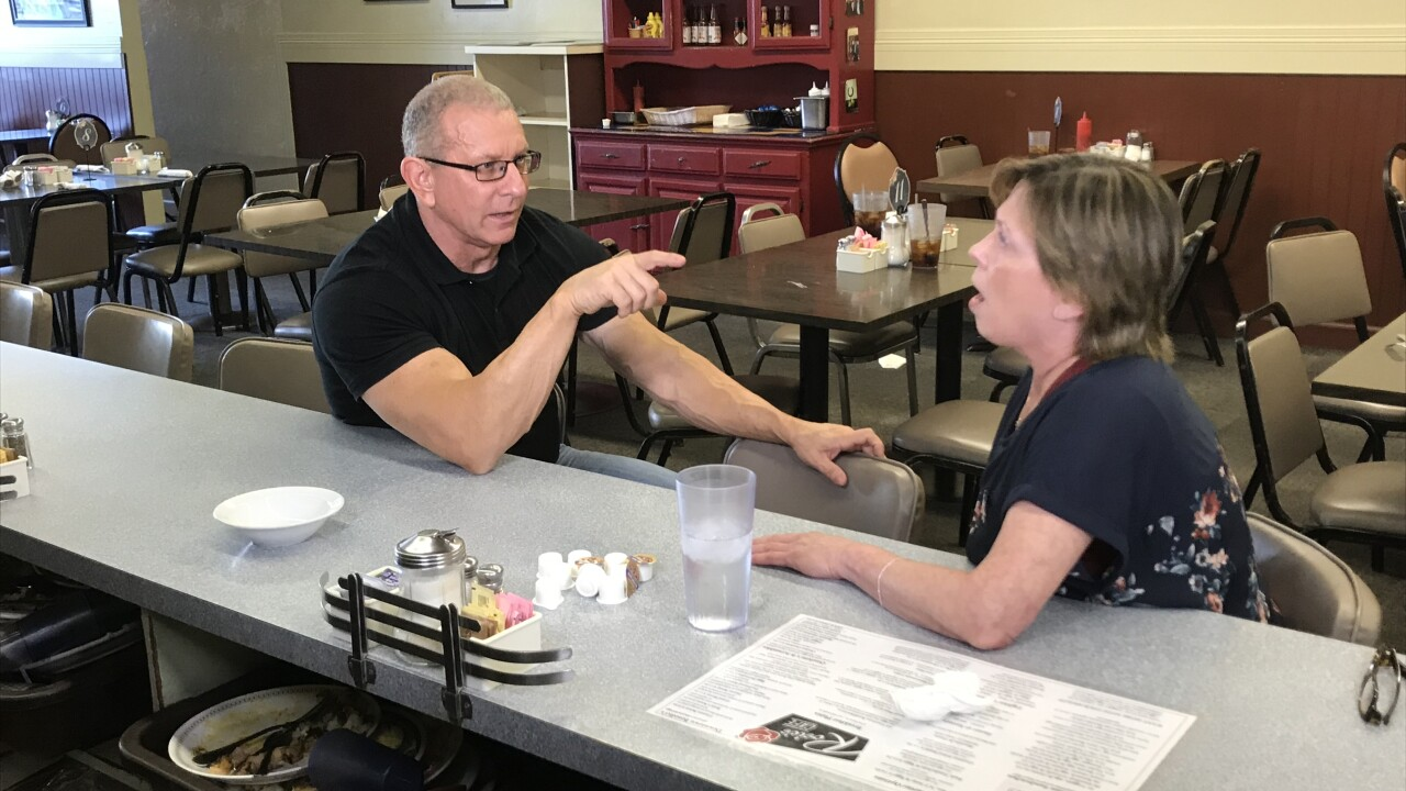 Robert speaks with Marie Pilsbury about her vision, as seen on Restaurant Impossible Rosie's Cafe.jpeg