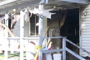 Kalispell house fire result in arrest and one death