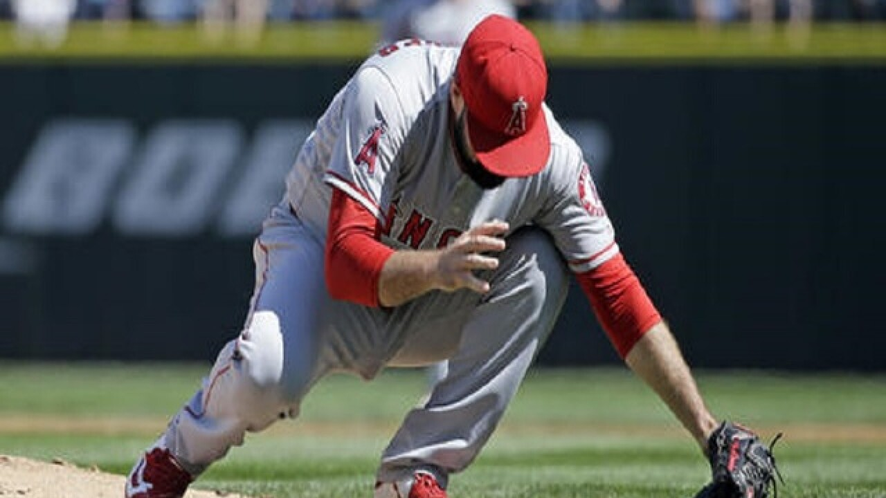 Angels' pitcher Matt Shoemaker leaves after being hit by baseball