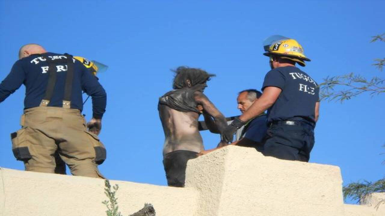 Tucson Fire crews rescue man from chimney