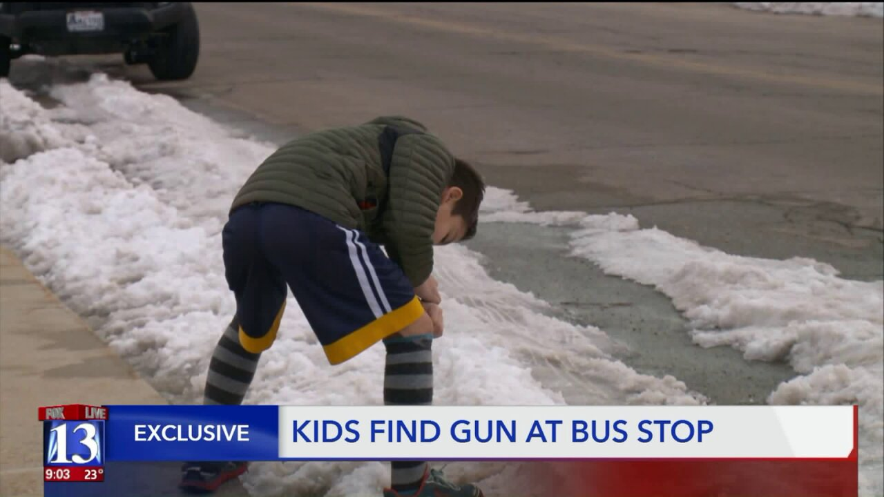9-year-old boys find suspect's gun buried in snow while waiting for school bus