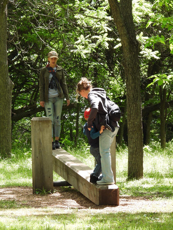 Kari Halweg, Selah Halweg and Matthew Halweg, all of Elkhorn, play on the seesaw at Nature Explore Classroom..JPG