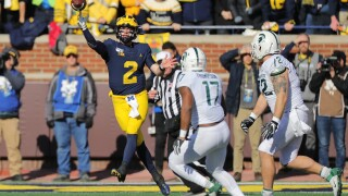 Shea Patterson throws 4 TD passes, No. 15 Michigan routs Michigan State