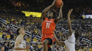 Ayo Dosunmu's shot lifts No. 21 Illinois over Michigan