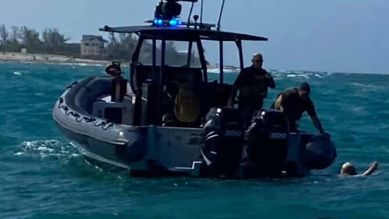 Martin County marine deputies rescue a couple from the St. Lucie Inlet on June 6, 2021 (1).jpg