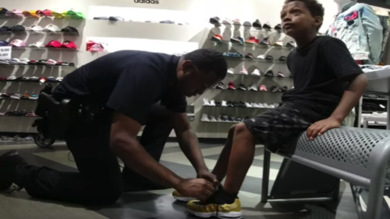 This Police Officer Will Buy A New Pair Of Shoes For Kids Who Can Score A Basket On Him