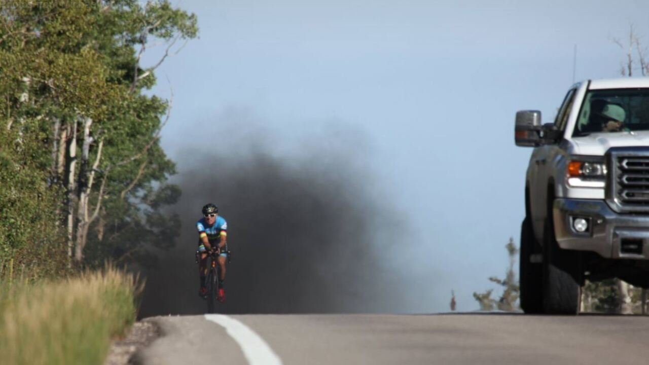 Cyclist upset after truck 'rolls coal' on him during Utah race