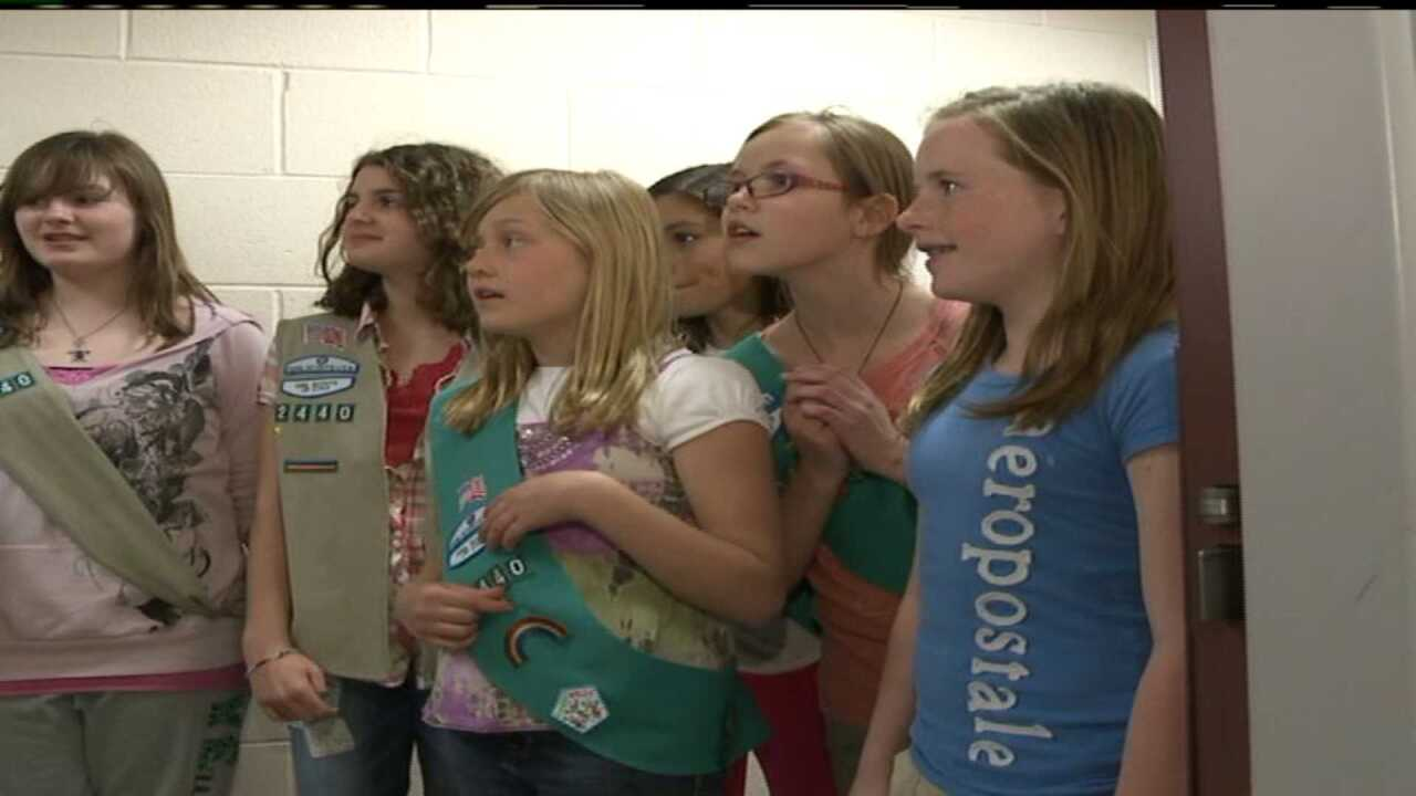 Girl scouts raise money, donate cookies for Ogden Police officers