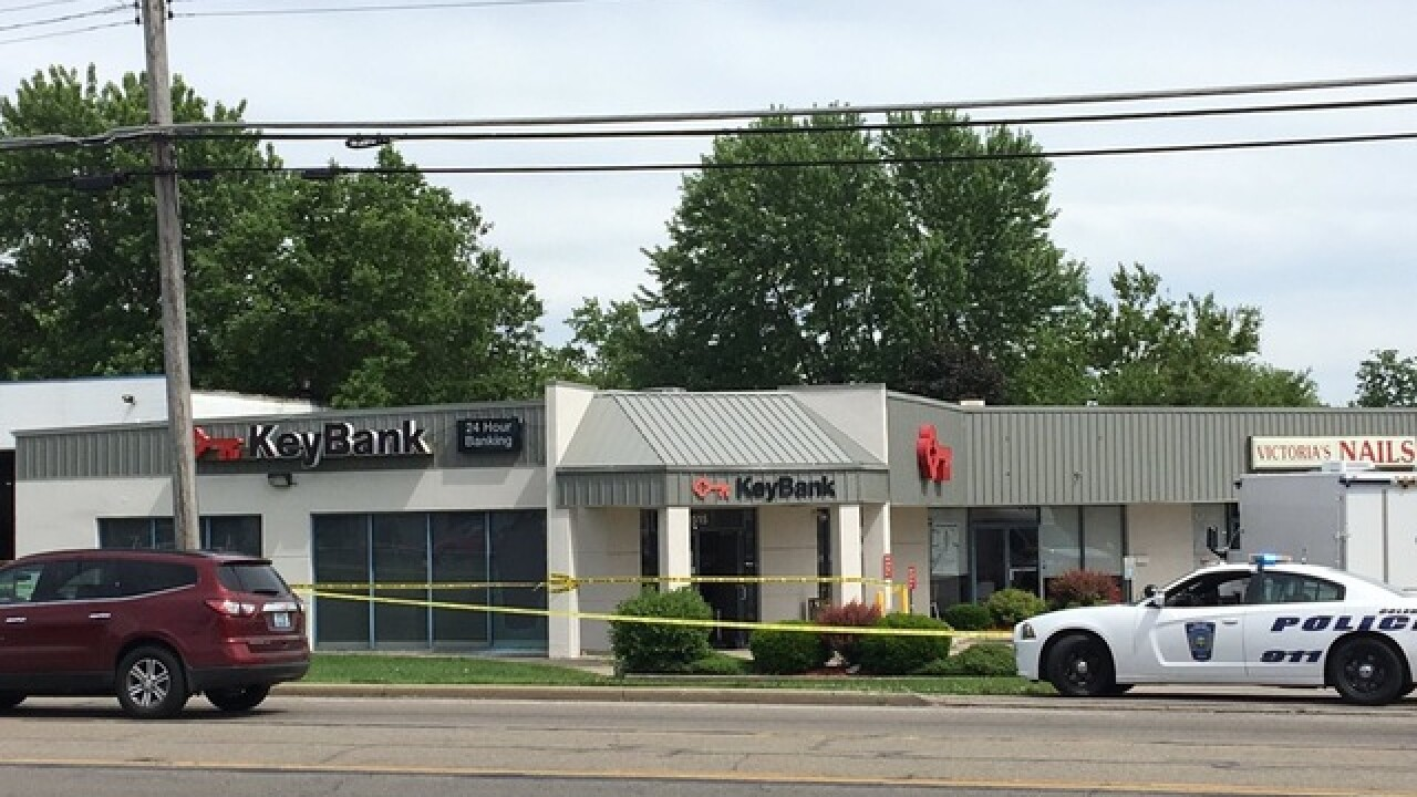 Key Bank robber, customer shoot at each other