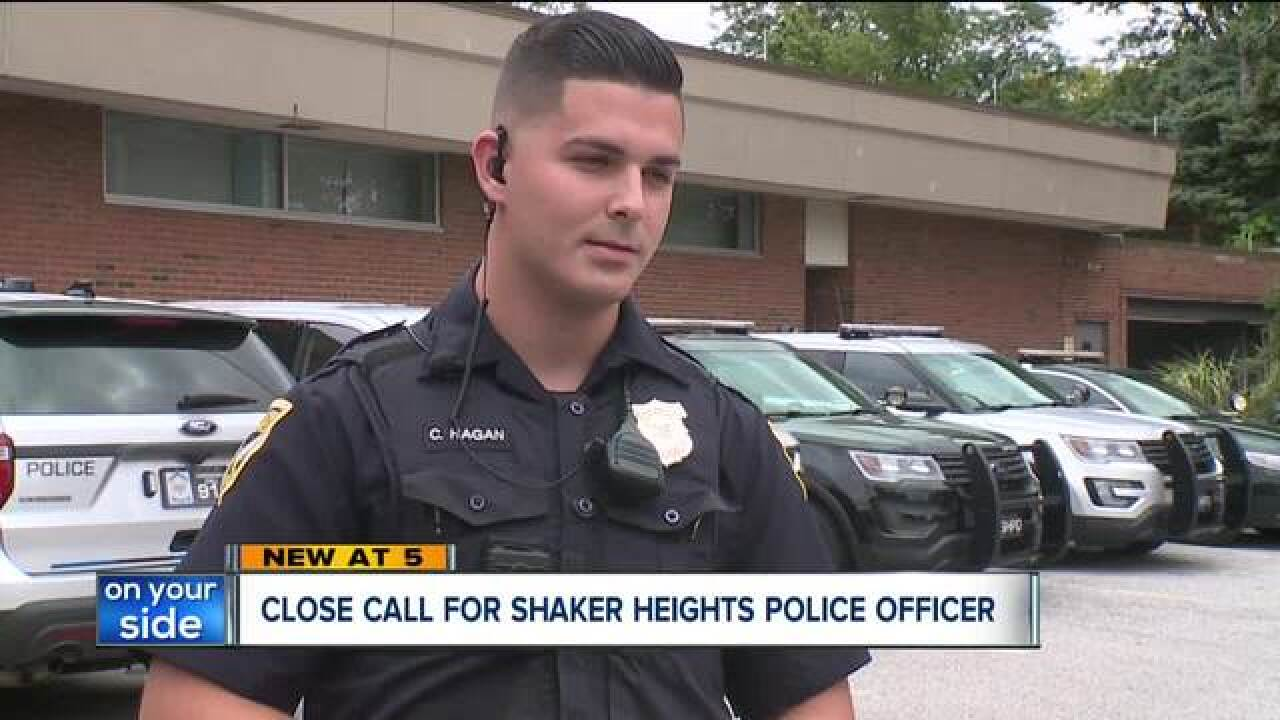 Shaker Heights officer nearly hit by car