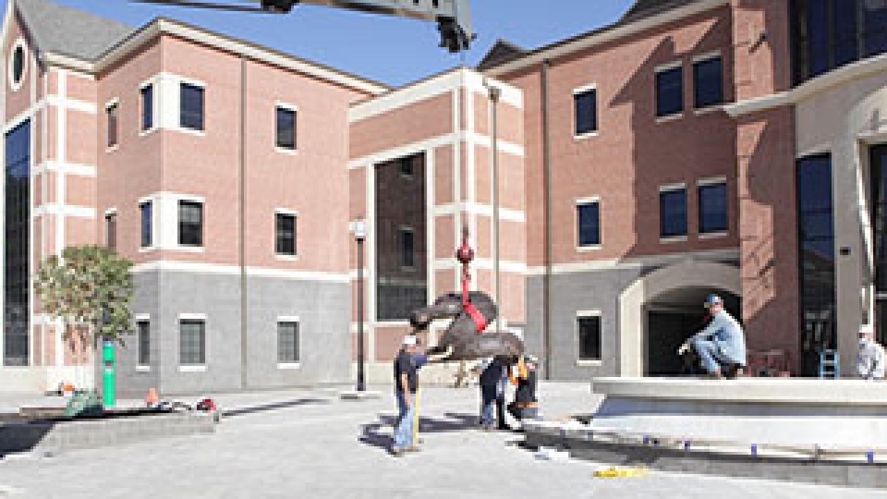 Bronze rattler installed in front of CASS Building