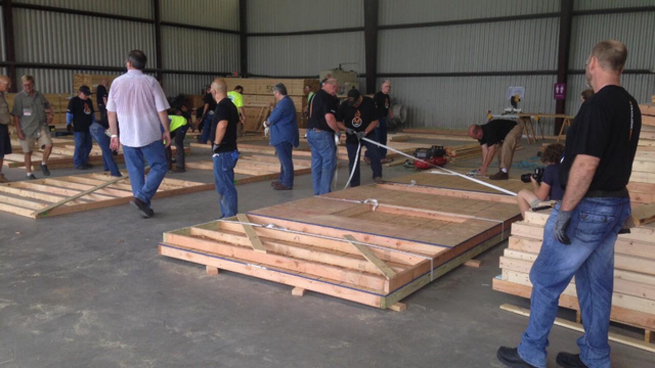 Volunteers build walls for Habitat for Humanity
