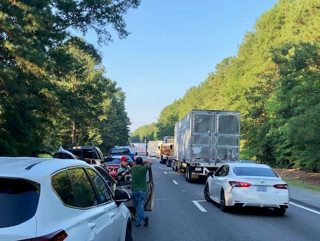 Photos: 5 injured in crash that shut down I-85; tractor-trailer drivercharged