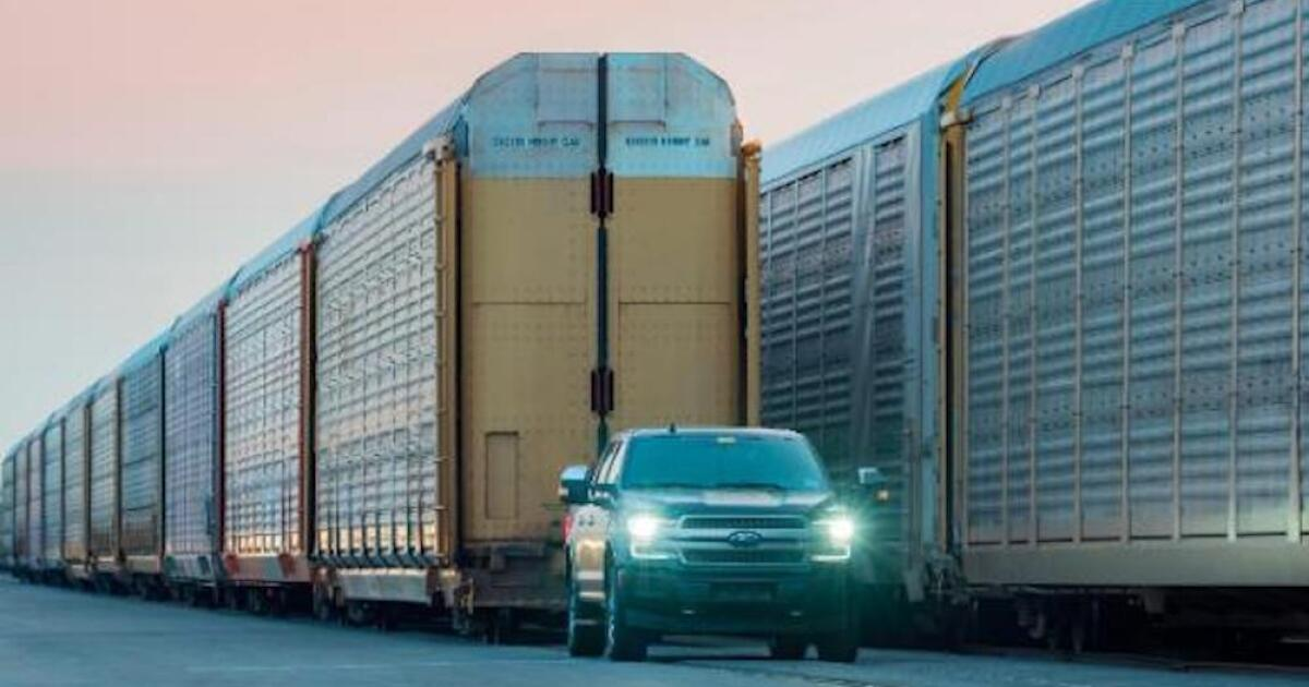 Ford shows off electric F-150 prototype, shows pickup towing freight train