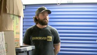Ryan David Standing in front of his belongings