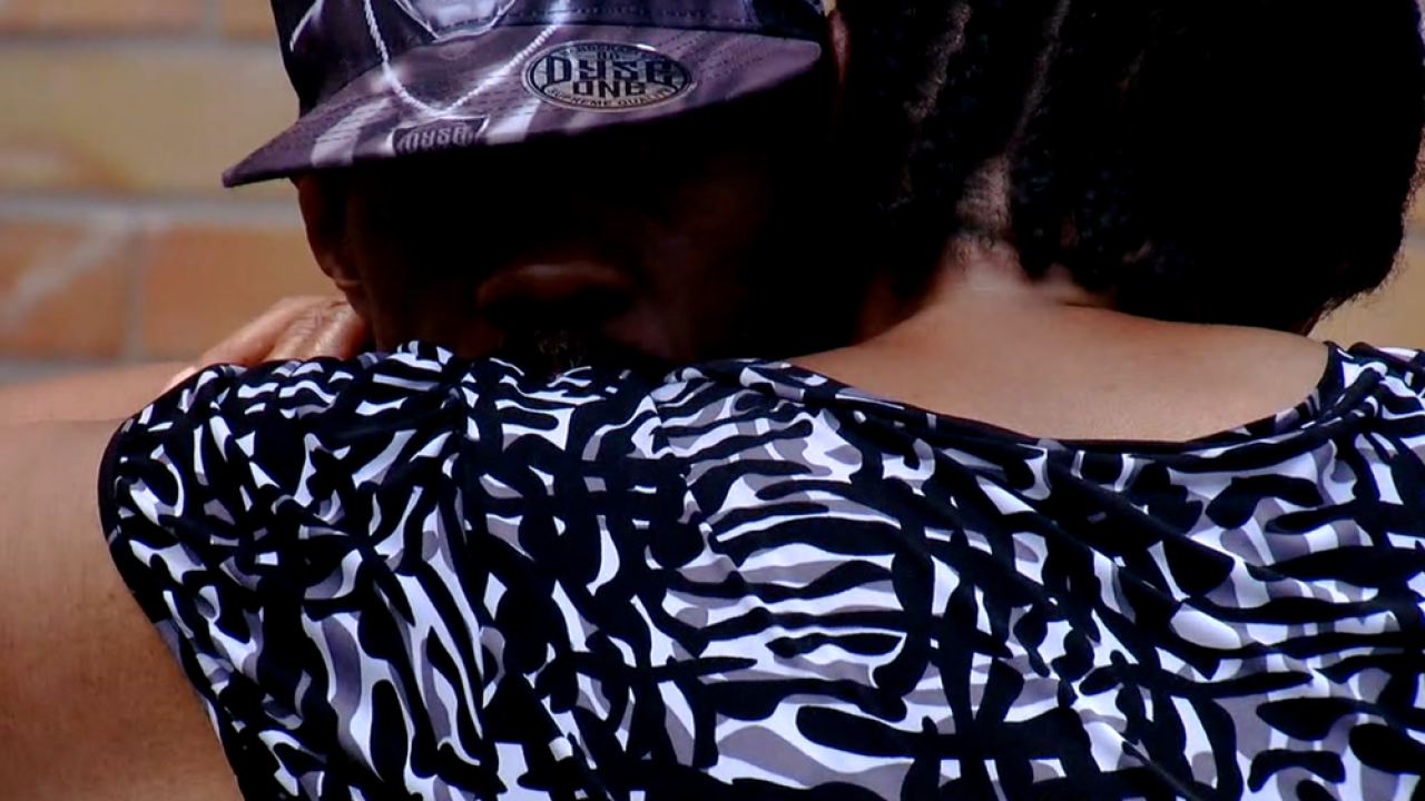 WCPO hugging at vigil.png