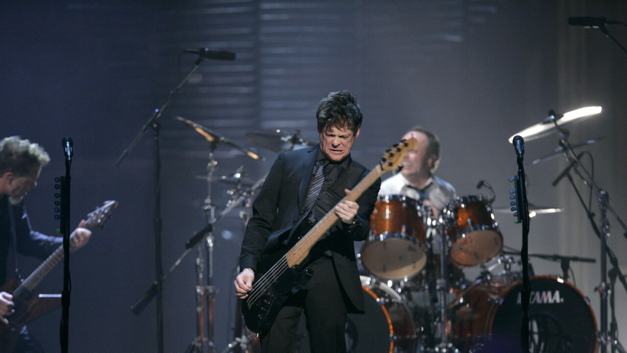 Jason Newsted of Metallica performs at Rock & Roll Hall of Fame in 2009