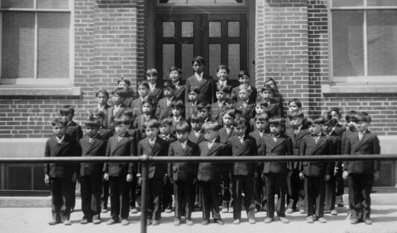 Boys standing in front of The Holy Childhood boarding school in Harbor Springs. Courtesy: Little Traverse Bay Bands of Odawa Indians archives