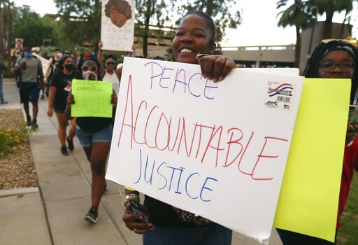 PHOTOS: Demonstrators peacefully protest the death of George Floyd