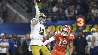 Notre Dame Fighting Irish QB Ian Book throws TD under pressure from Clemson Tigers in College Football Playoff semifinal at Cotton Bowl