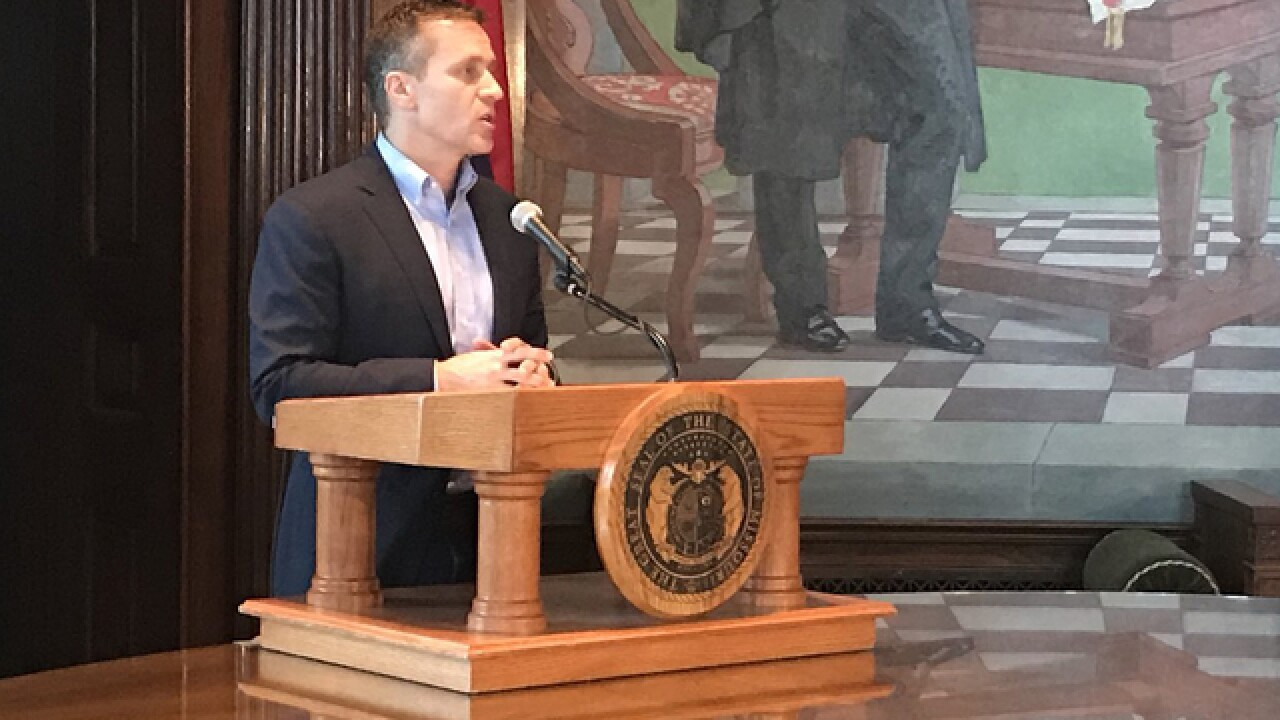 Report: Woman says Greitens 'coaxed' her as 'wounded animal'