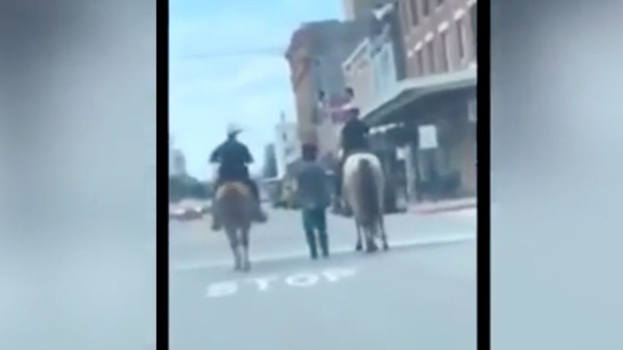 Police unions defend the mounted officers who escorted a handcuffed man