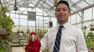 Andrew and Parrot at Botanical Gardens.jpeg