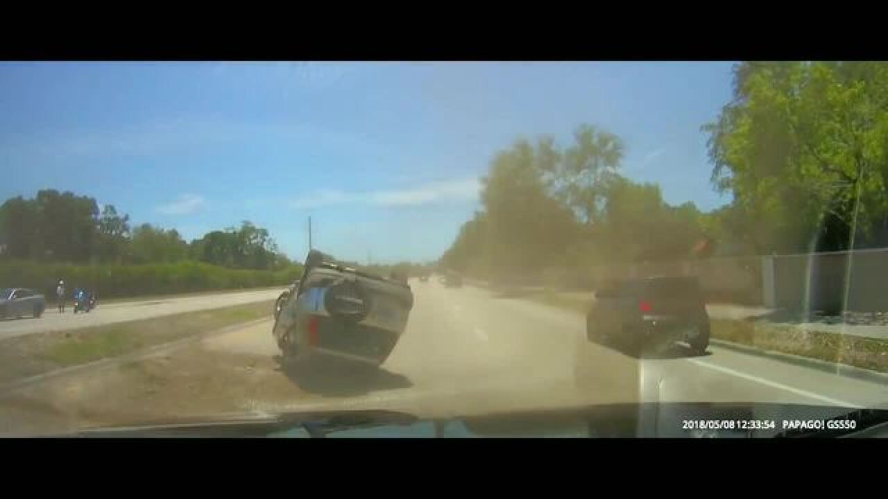 Video: SUV rolls over to avoid hitting deputy