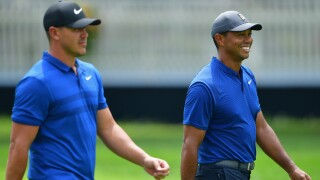 Brooks Koepka and Tiger Woods of the United States walk together during a practice round prior to the 2018 PGA Championship at Bellerive Country Club on August 8, 2018 in St Louis, Missouri. (Photo by Stuart Franklin/Getty Images)