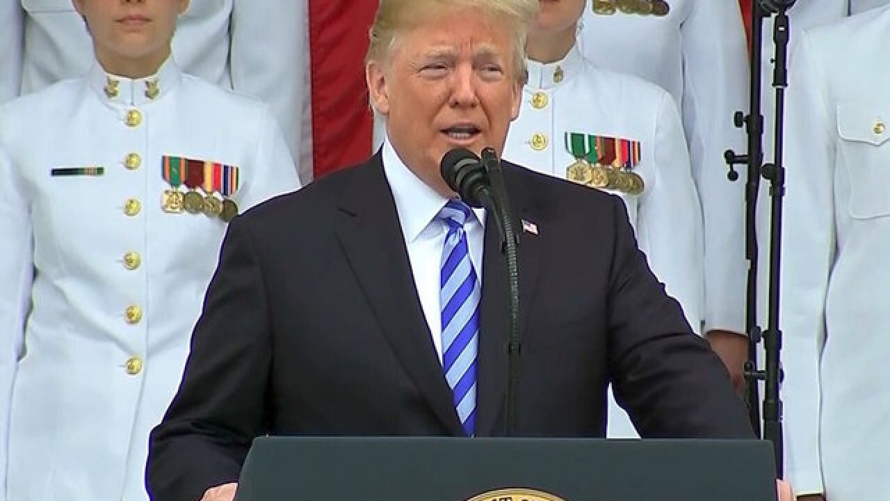 Trump honors fallen service members at Arlington National Cemetery