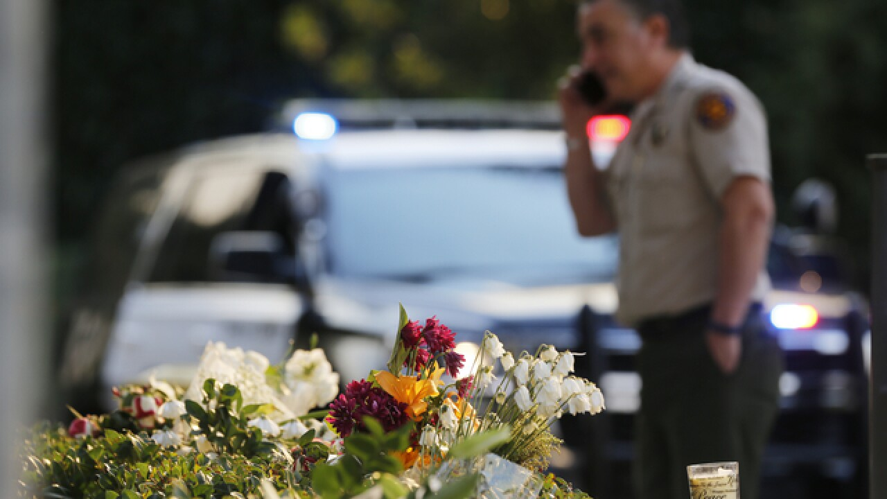 Gunman who killed 12 died from self-inflicted gunshot