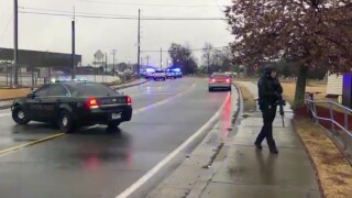 Authorities say they're looking for a shooter after gunfire was reported at a food-service packaging plant in north Georgia, and area schools are on lockdown.