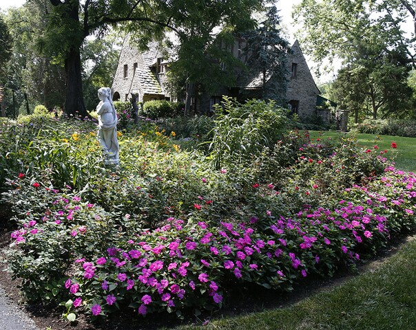 Home Tour: The gardens in this Park Hills home evoke the gardens of Europe