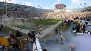 Packers players take the field