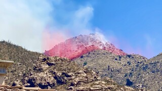 A DC-10 airtanker drops fire retardant on the Bighorn Fire in the Catalina Mountains