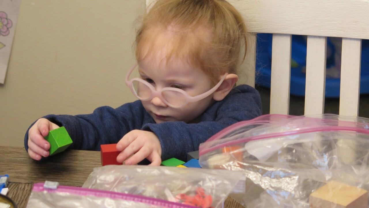 Ellie Arsenault playing with blocks