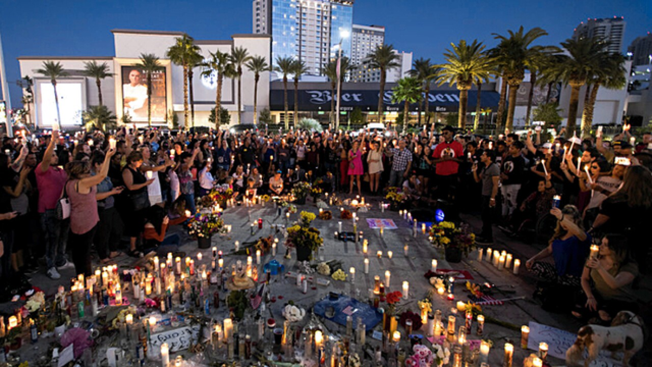 Las Vegas pauses but looks ahead a year after mass shooting
