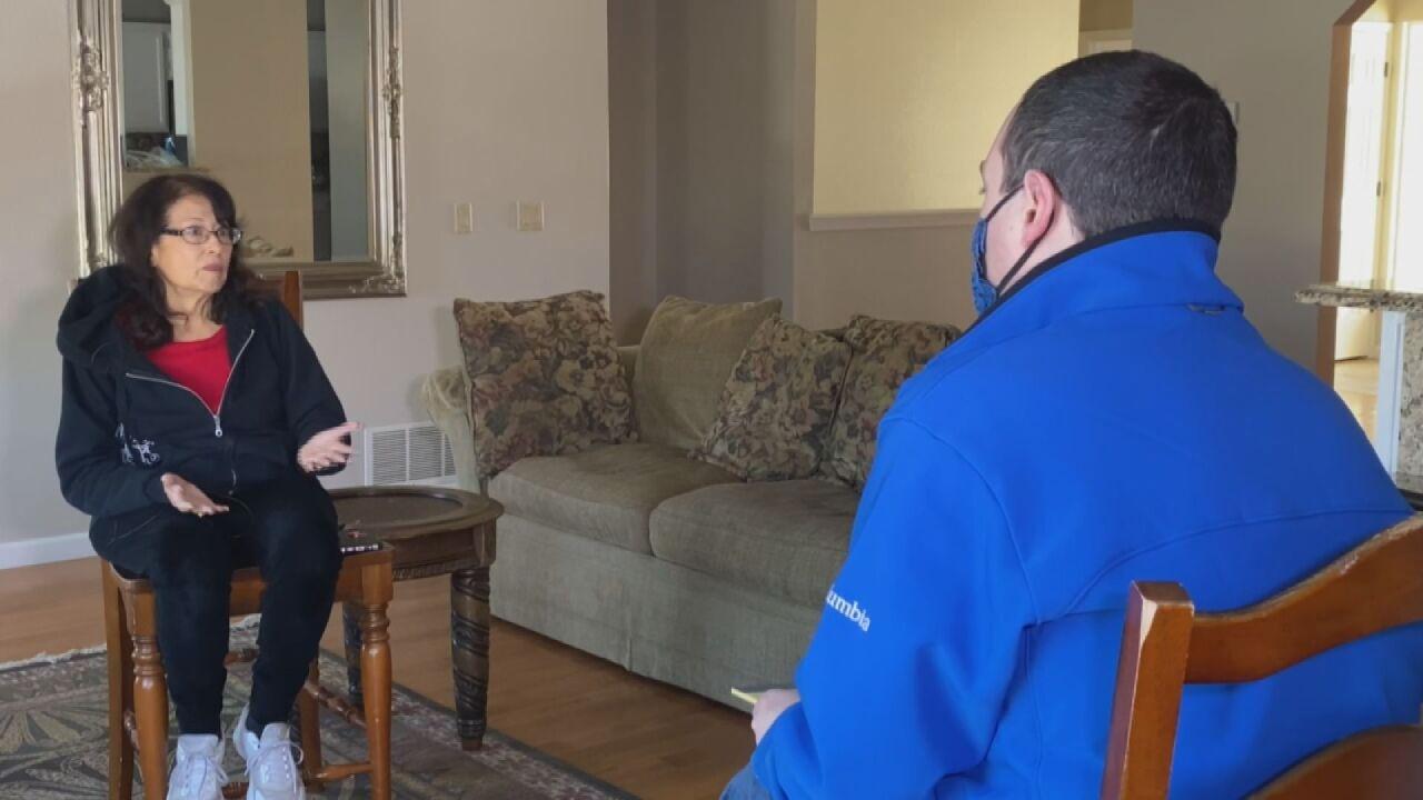 Mimi Vigil talking with Chief Investigative Reporter Eric Ross