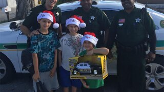 Deputies bring Christmas joy to family of boy on Autism spectrum