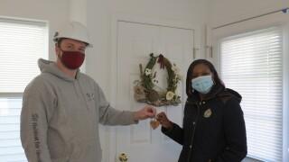 AmeriCorps member Nick hands Ruby her key.JPG